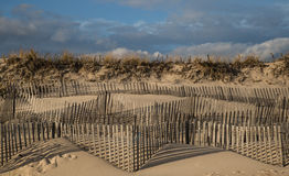 Sand dune windswept fences in East Hampton New York. Shadows of windswept fencing on Main Beach East Hampton New York Royalty Free Stock Photography