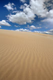 Sand dunes. And with clouds Stock Photo