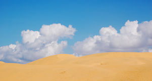 Sand dunes. In a desert with cloudy sky in the background stock photos
