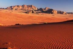 Sand dunes. Sand dune ripples around sunset hour in the Wadi Rum desert, Jordan Royalty Free Stock Photo