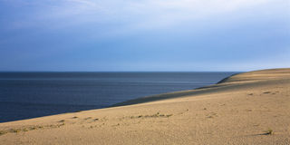 Sand Dunes. And bright blue sky. Curonian Spit, Russia royalty free stock photo