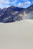 Sand dunes against the Himalayas background Stock Photo