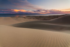 Sand dunes on the background of the desert lake. Royalty Free Stock Images