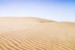 Sand dunes on the beach in Maspalomas. Royalty Free Stock Photography