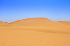 Sand dunes and beautiful cloudless sky Stock Images