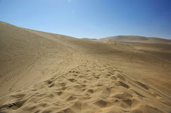 Sand dunes with blue sky Royalty Free Stock Images