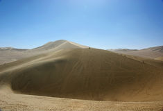 Sand dunes and blue sky Royalty Free Stock Image
