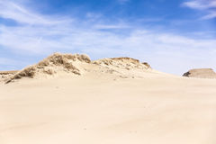 Sand dunes and blue sky with clouds Royalty Free Stock Photography