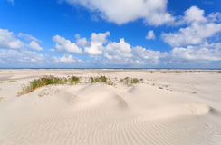 Sand dunes and blue sky at coast Royalty Free Stock Photography