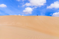 Sand dunes in Boavista desert with blue sky and clouds, Cape Ver Royalty Free Stock Image