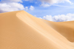 Sand dunes in Boavista desert with blue sky and clouds, Cape Ver Royalty Free Stock Photography