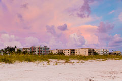 Sand dunes and buildings on the beach in Florida under  beautifu Stock Image