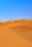 Sand dunes and cloudless sky Stock Photos