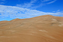 Sand Dunes and Clouds with Blue Skies Stock Images