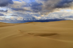 Sand dunes clouds horiz Royalty Free Stock Image
