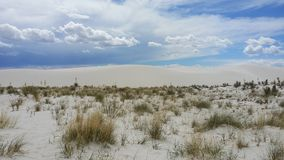 Sand dunes and clouds royalty free stock photos