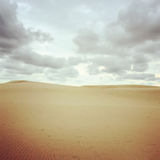 Sand dunes and cloudy sky Royalty Free Stock Image
