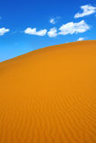 Sand dunes and cumulus clouds Stock Photo