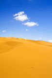 Sand dunes and cumulus clouds Royalty Free Stock Photos