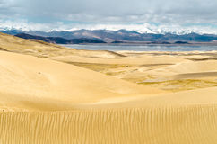 Sand dunes in a desert area of the Tibetan Plateau Royalty Free Stock Photos