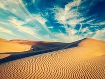 Sand dunes in desert Stock Images