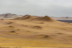 Sand dunes of different sizes and colors Stock Photo