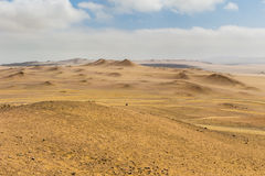 Sand dunes of different sizes, shapes and colors Stock Photo