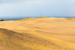 Sand dunes of different sizes and shapes Stock Image