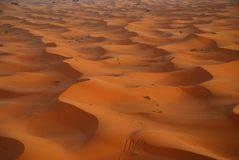 Sand dunes. Erg Chebbi, Sahara, Morocco. Erg Chebbi is one of Moroccos two Saharan ergs, large dunes formed by wind-blown sand Stock Images