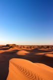 Sand dunes of Erg Chigaga. View of sand dunes of Erg Chigaga with clear blue sky Stock Photography