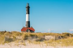 Sand dunes and Fire Island Lighthouse on Long Island, New York.  royalty free stock photos