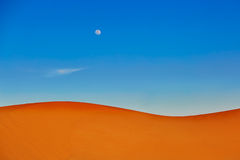 Sand dunes and almost full moon Stock Image