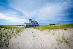 Sand dunes and grasses, and the Old Harbor U.S. Life Saving Stat Royalty Free Stock Photo