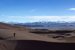 Sand dunes and Himalayas along China-Nepal Border, Tibet Royalty Free Stock Photos