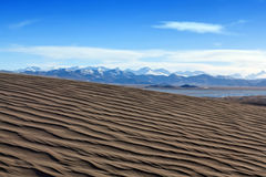 Sand dunes and Himalayas along China-Nepal Border, Tibet Royalty Free Stock Photo