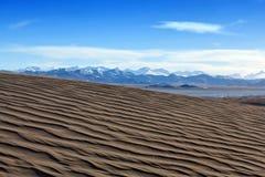 Sand dunes and Himalayas along China-Nepal Border, Tibet Royalty Free Stock Photo