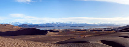 Sand dunes and Himalayas along China-Nepal Border, Western Tibet Royalty Free Stock Photos