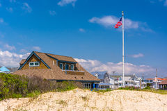 Sand dunes and houses in Ocean City, New Jersey. Royalty Free Stock Images