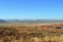 Sand dunes in the Kalahari desert. Lunar panoramic landscape with red sand dunes in the Kalahari Desert, Namibia, Africa royalty free stock photo
