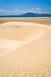 Sand dunes and lake Royalty Free Stock Image