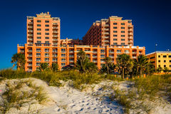 Sand dunes and large hotel in Clearwater Beach, Florida. Royalty Free Stock Photo