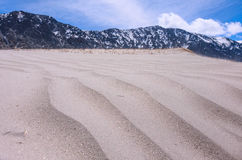 Sand dunes in the mountains Stock Image