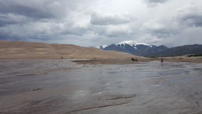 Sand Dunes, Mountains and Storm Stock Photo