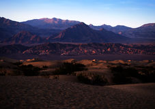 Sand Dunes and Mountains in sunrise Royalty Free Stock Photos