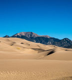 Sand Dunes and Mountains Stock Image