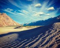 Sand dunes in mountains Stock Photos