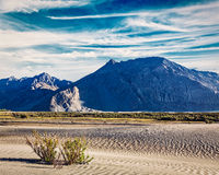 Sand dunes in mountains Royalty Free Stock Images