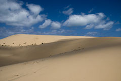 Sand dunes in Mozambique, Africa. A beautiful cloudscape in Mozambique at the Bazaruto archipelago.  Great cloud shadows Stock Photos
