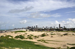 Sand dunes at Natal, Rio Grande do Norte (Brazil). Sand duneswith skyscrapers of Natal in background, Rio Grande do Norte (Brazil Stock Photos