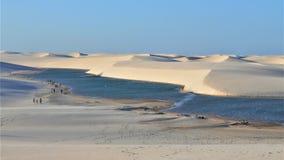 Sand Dunes and Natural pool of rain water in the Desert of Lençois Maranhenses in Brasil. Dunes of Sand and Rainwater Pools at Dusk in Lençóis stock photo